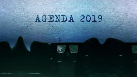 Agenda 2019 words Typing on a sheet of paper with an old vintage typewriter Live Action