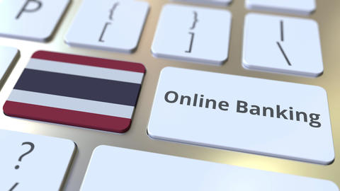 Online Banking text and flag of Thailand on the keyboard. Internet finance ライブ動画