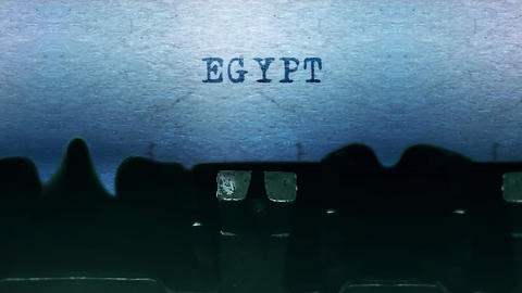 Egypt words Typing on a sheet of paper with an old vintage typewriter Live Action