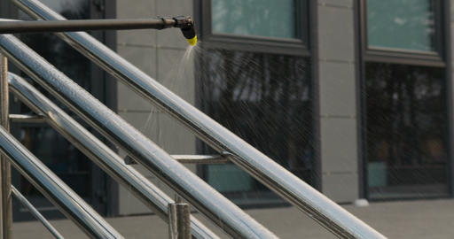 Spraying chemicals on handrails. Sanitary measures against coronavirus in public Live Action
