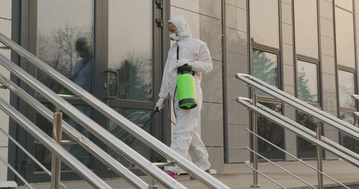 Worker in a protective suit disinfects surfaces from coronavirus. Antibacterial Live Action