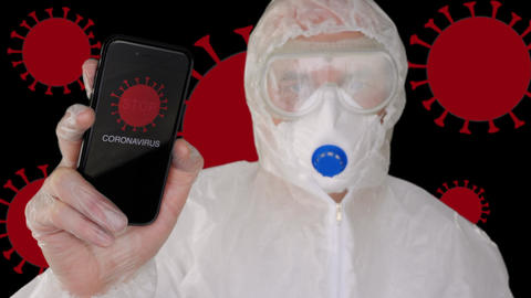 Virologist in protective suit and mask showing mobile with sign stop corona ライブ動画