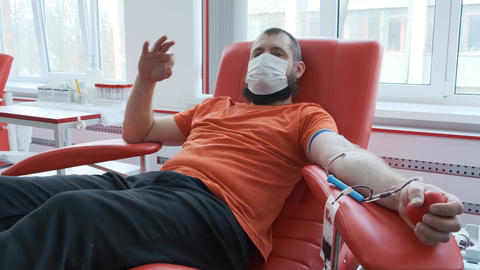 Blood donor makes okay gesture. Mature man with beard showing ok sign and Live Action