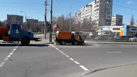 KIEV, UKRAINE - MARCH 31, 2020: The work of public services for cleaning streets and roads, repair Live Action