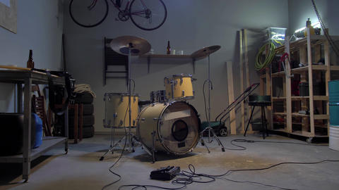 Garage with a drum where musicians rehearse Live Action