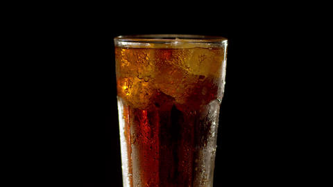 Misted glass of cola turning Live Action