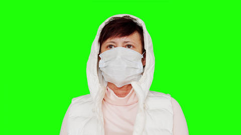 Woman in Medical Mask on a Green Screen Live Action