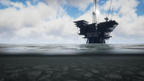 Large Pacific Ocean offshore oil rig drilling platform Live Action