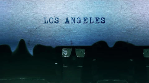 LOS ANGELES words Typing on a sheet of paper with an old vintage typewriter Live Action