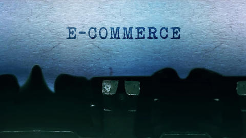 E-Commerce words Typing on a sheet of paper with an old…, Live Action