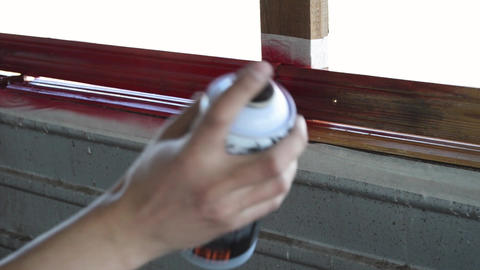 Paint a can of paint paint a wooden wall in red video footage Live Action