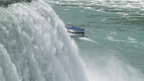 Slow Motion Close Up of Niagara Falls and Boat in the River Live Action