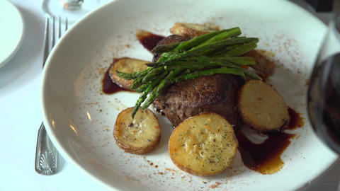 Right pan of a fillet mignon meal with red wine Footage