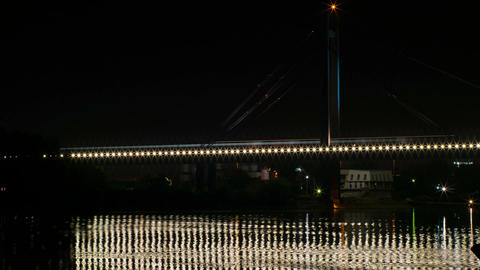 Railway bridge over the river lights flickering at night ビデオ
