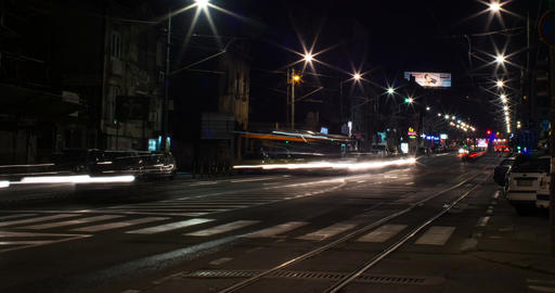 Street night timelapse. Cars pass traffic lights change Footage