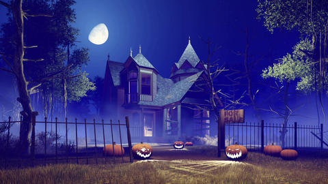 Halloween pumpkins and scary haunted house at misty night Footage