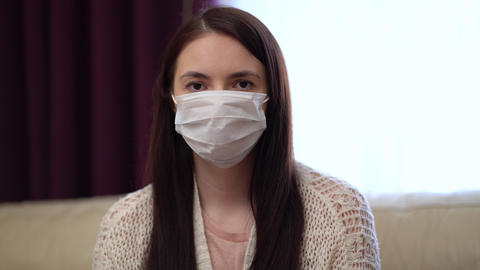 Young Woman Wearing Protective Mask at Home Live Action