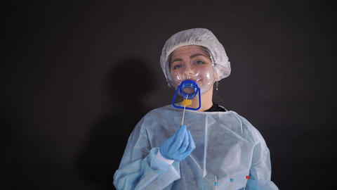 Young woman in protective clothing. On the face of a protective medical mask Live Action
