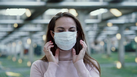 The girl wears a protective mask on her face Live Action