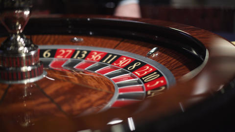 Roulette in the casino spins and white ball Live Action