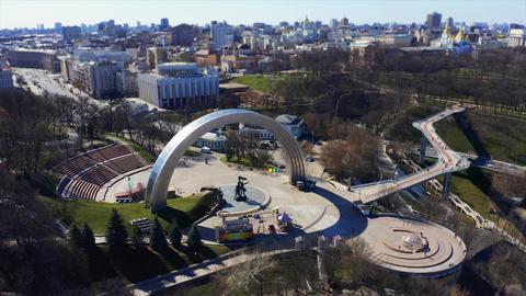 People Friendship Arch and pedestrian bridge of Klitschko. Reunion Arch in Kyiv Live Action