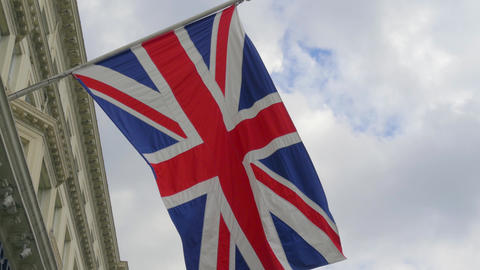 British flag close-up on a flagpole against a sky Live Action