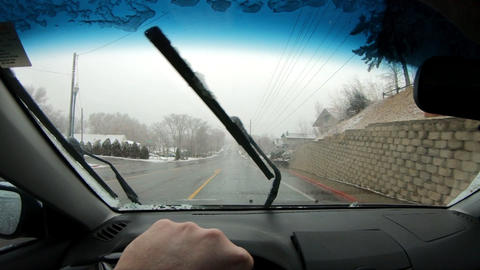 Driver POV while driving in light snow storm Live Action