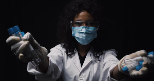 Infectionist doctor breaks test tubes with virus in the laboratory Live Action