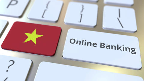 Online Banking text and flag of Vietnam on the keyboard. Internet finance Live Action