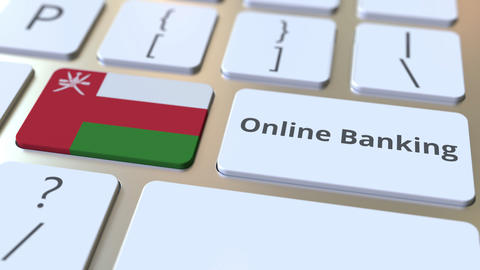 Online Banking text and flag of Oman on the keyboard. Internet finance related Live Action