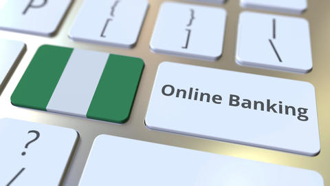 Online Banking text and flag of Nigeria on the keyboard. Internet finance Live Action