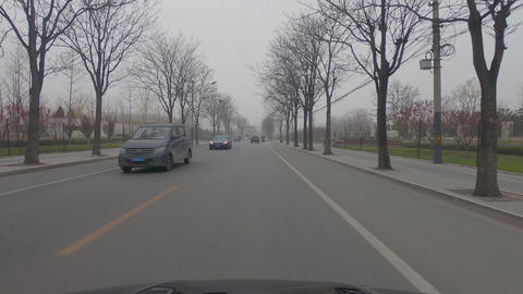 Car POV driving on the road during grey weather pollution day. Beijing. China Live Action