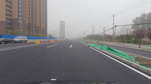 POV car driving on a new road construction during extreme gray pollution day Live Action