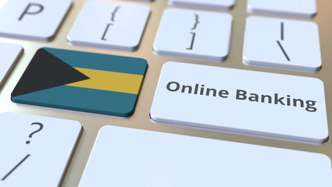 Online Banking text and flag of the Bahamas on the keyboard. Internet finance Live Action