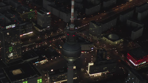 AERIAL: Over Berlin Germany TV Tower Alexanderplatz at Night with City Lights Live Action