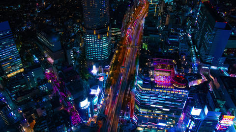 A night timelapse of the neon town in Shibuya Tokyo high angle wide shot tilt Live Action