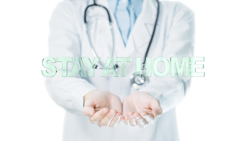 The word is stay at home on hands doctor on white background for self quarantine times Photo