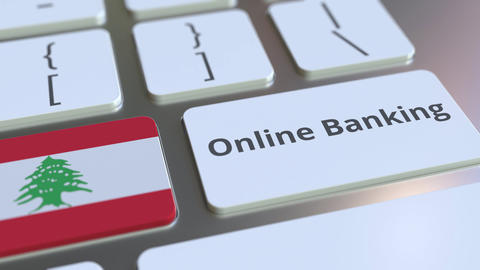 Online Banking text and flag of Lebanon on the keyboard. Internet finance Live Action