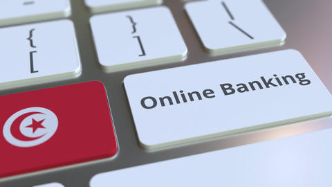 Online Banking text and flag of Tunisia on the keyboard. Internet finance Live Action