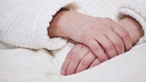 Close up of Hands of an old woman folded one over the other. Elderly woman with Live Action