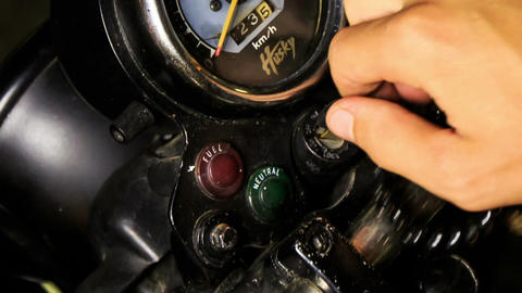 Closeup Guy Hand Switches on Motorcycle Engine on Control Board Footage