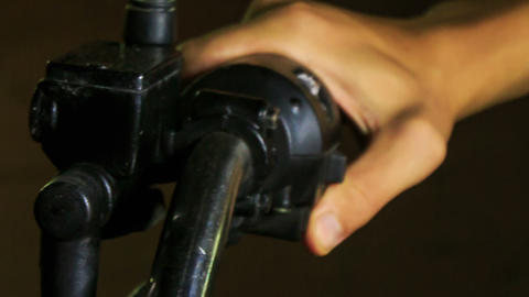 Closeup Guy Hand Turns Motorcycle Handle at Control Board Footage