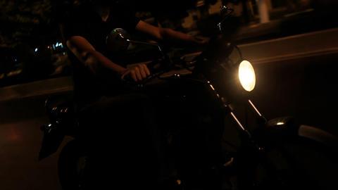 Closeup Guy in Helmet Speeds on Motorcycle along Asphalt Road Footage