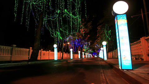Colourful Night Road Illumination with Streetlight Poles Footage