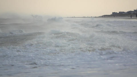 Angry storm surge washes ashore Footage