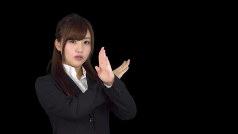 Young Japanese business woman wrong sign Footage