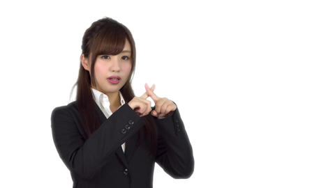 Young Japanese business woman wrong sign Live Action
