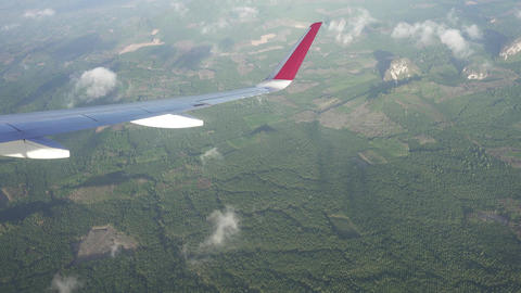 Flying on airplane over Krabi province, Thailand ビデオ