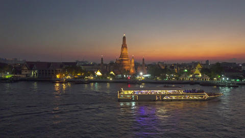 Wat Arun buddhist temple and boats in Bangkok Footage
