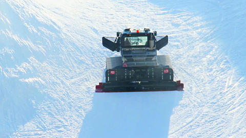 Snow groomer, piste basher cleaning skiing run, winter Olympics Footage